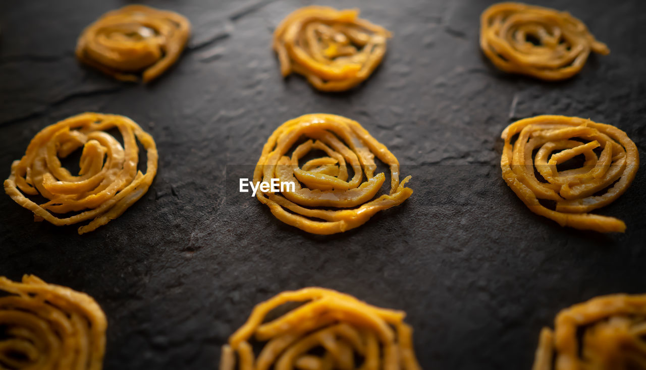 sweet food, food and drink, food, still life, baked, freshness, indoors, sweet, unhealthy eating, temptation, dessert, no people, indulgence, selective focus, ready-to-eat, snack, cookie, table, close-up, in a row, preparing food, baking sheet