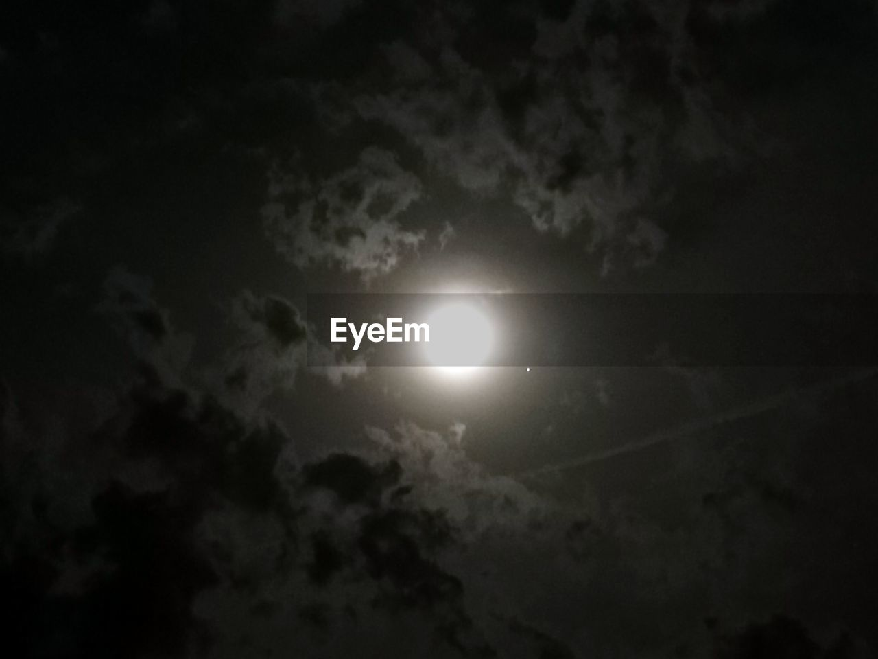 sky, cloud - sky, moon, beauty in nature, night, astronomy, low angle view, space, tranquility, full moon, scenics - nature, nature, moonlight, outdoors, no people, tranquil scene, solar eclipse, glowing, majestic, eclipse, planetary moon