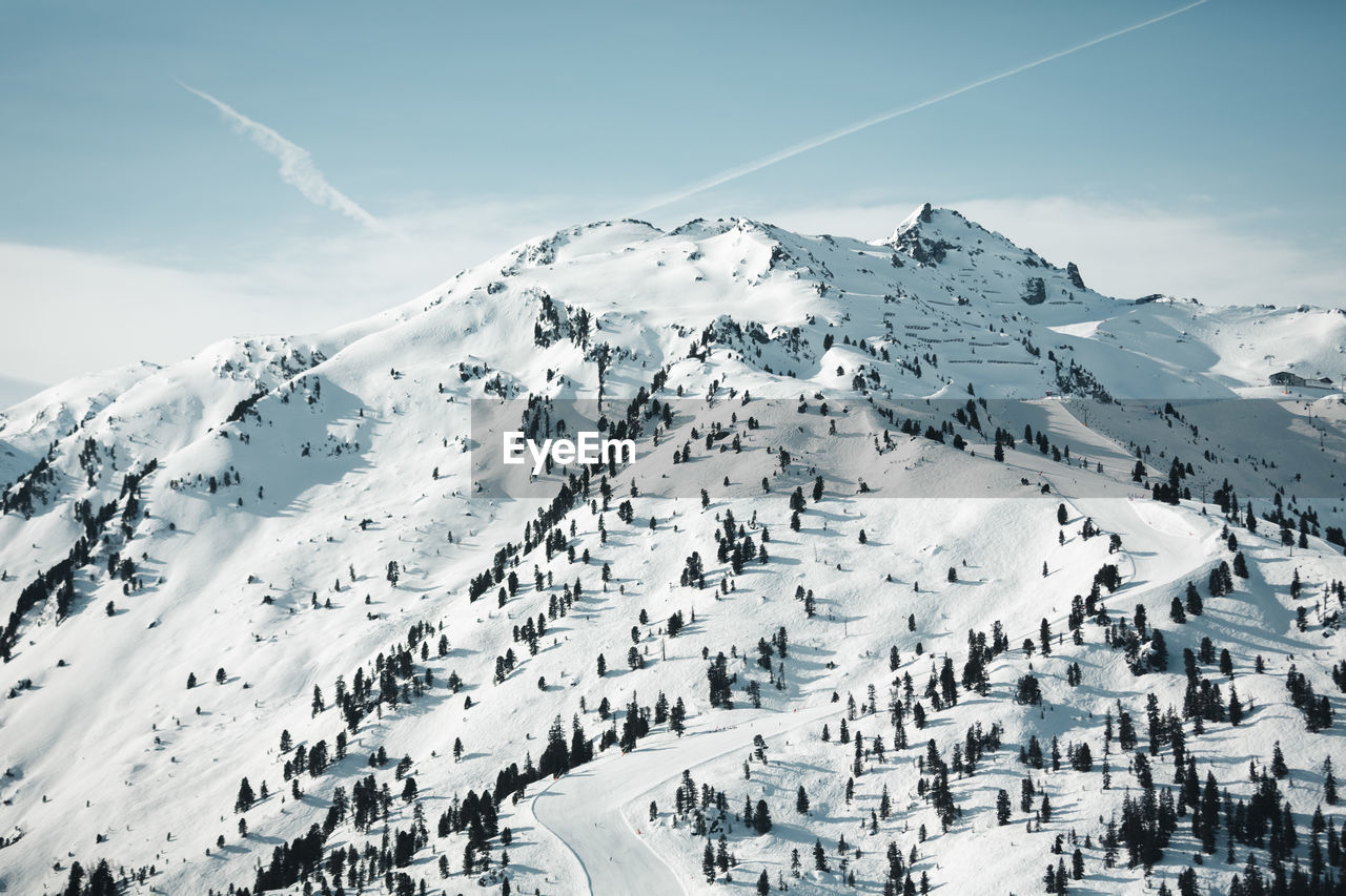 High angle view of snow covered mountains against sky
