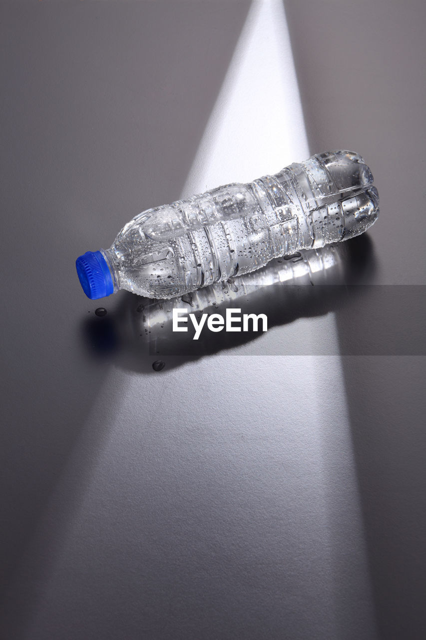 Close-up of water bottle on gray background