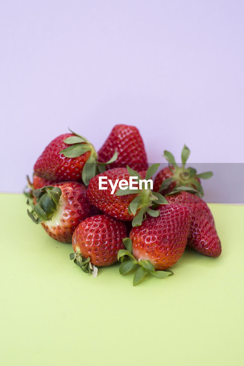 fruit, strawberry, healthy eating, food and drink, food, berry fruit, studio shot, wellbeing, freshness, red, indoors, still life, close-up, no people, copy space, colored background, cut out, group of objects, green color, white background, temptation, lychee