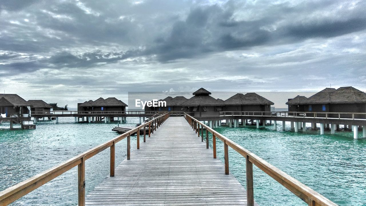 built structure, architecture, water, cloud - sky, building exterior, sky, pier, no people, wood - material, building, day, nature, beauty in nature, stilt house, sea, railing, house, scenics - nature, tranquility, outdoors