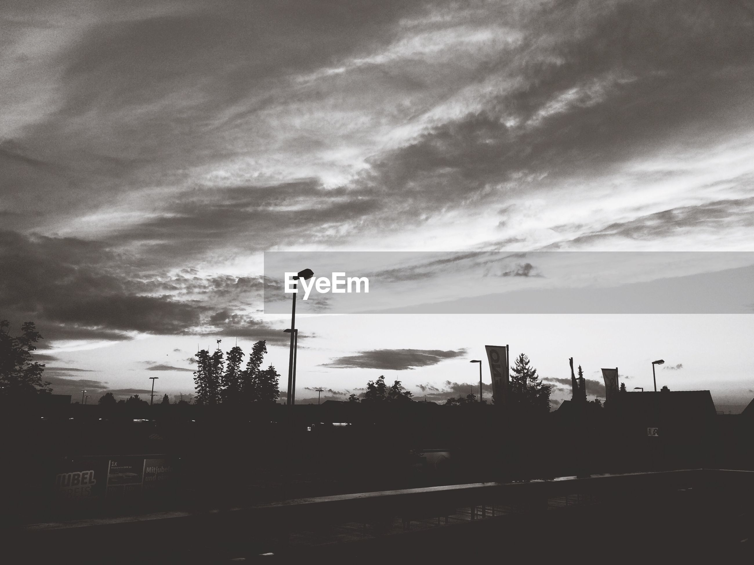 sky, cloud - sky, silhouette, cloudy, built structure, building exterior, architecture, cloud, street light, weather, dusk, overcast, sunset, road, transportation, nature, outdoors, street, no people, city