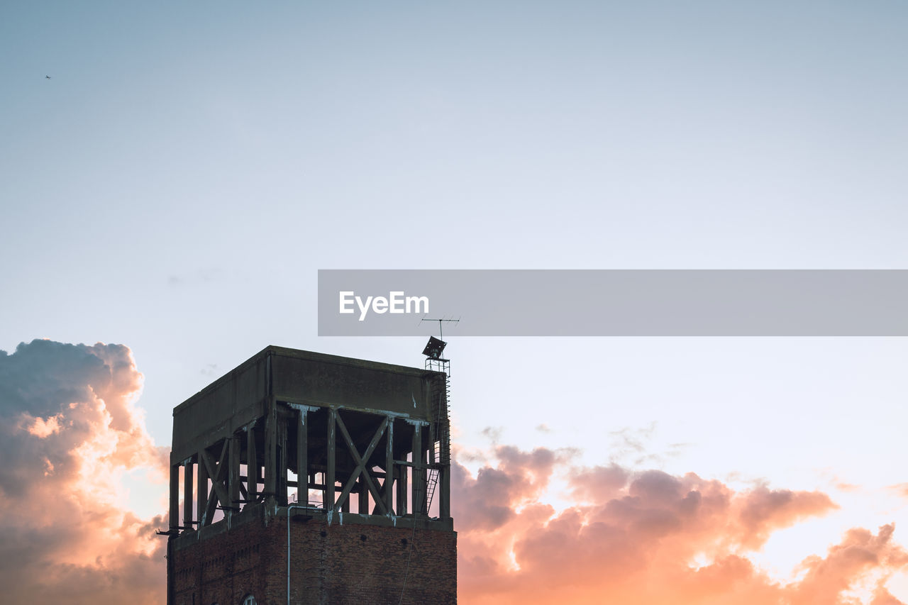 Low Angle View Of Incomplete Building Against Sky During Sunset