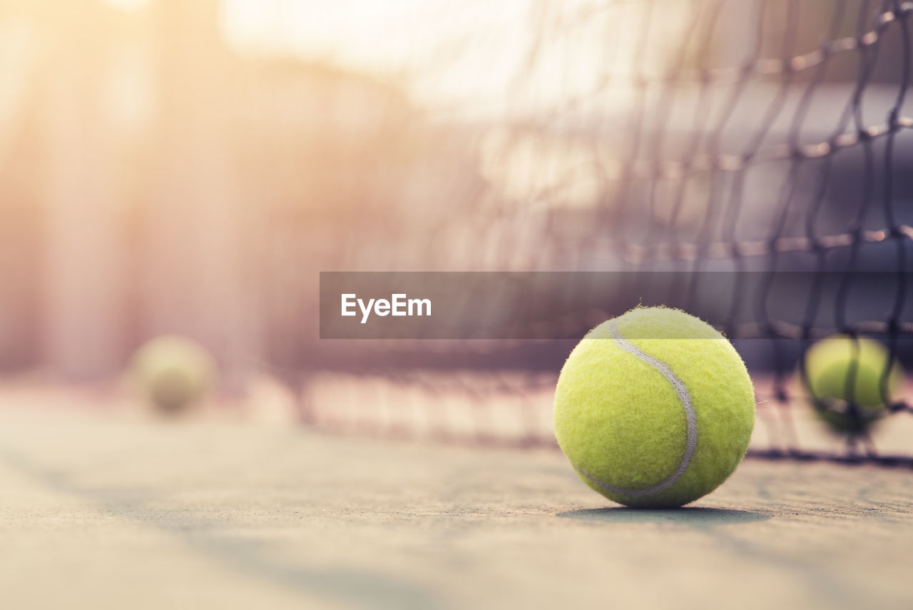 Close-up of tennis balls on court