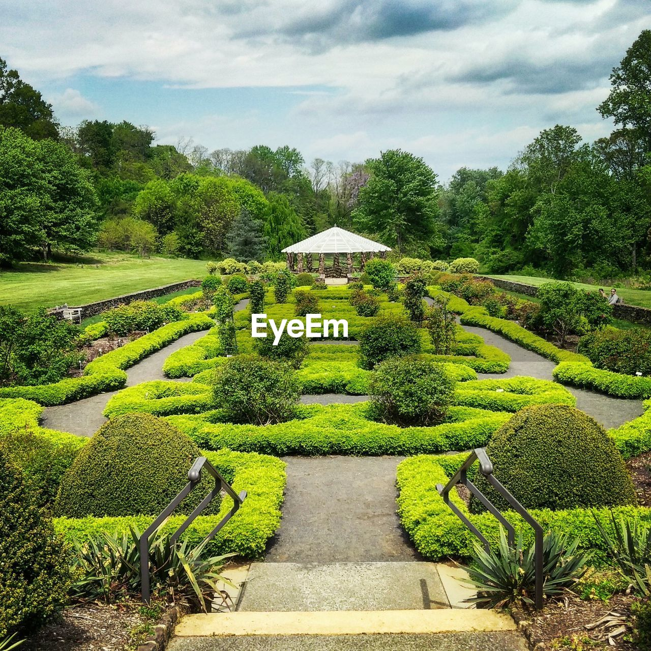 plant, green color, growth, tree, cloud - sky, nature, formal garden, sky, no people, architecture, tranquility, beauty in nature, garden, day, tranquil scene, hedge, topiary, direction, scenics - nature, the way forward, outdoors, garden path, ornamental garden