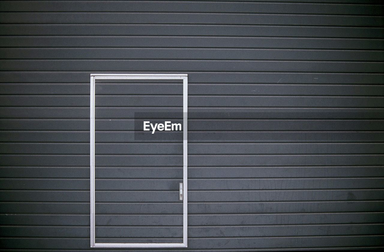 Closed Door On Gray Wall