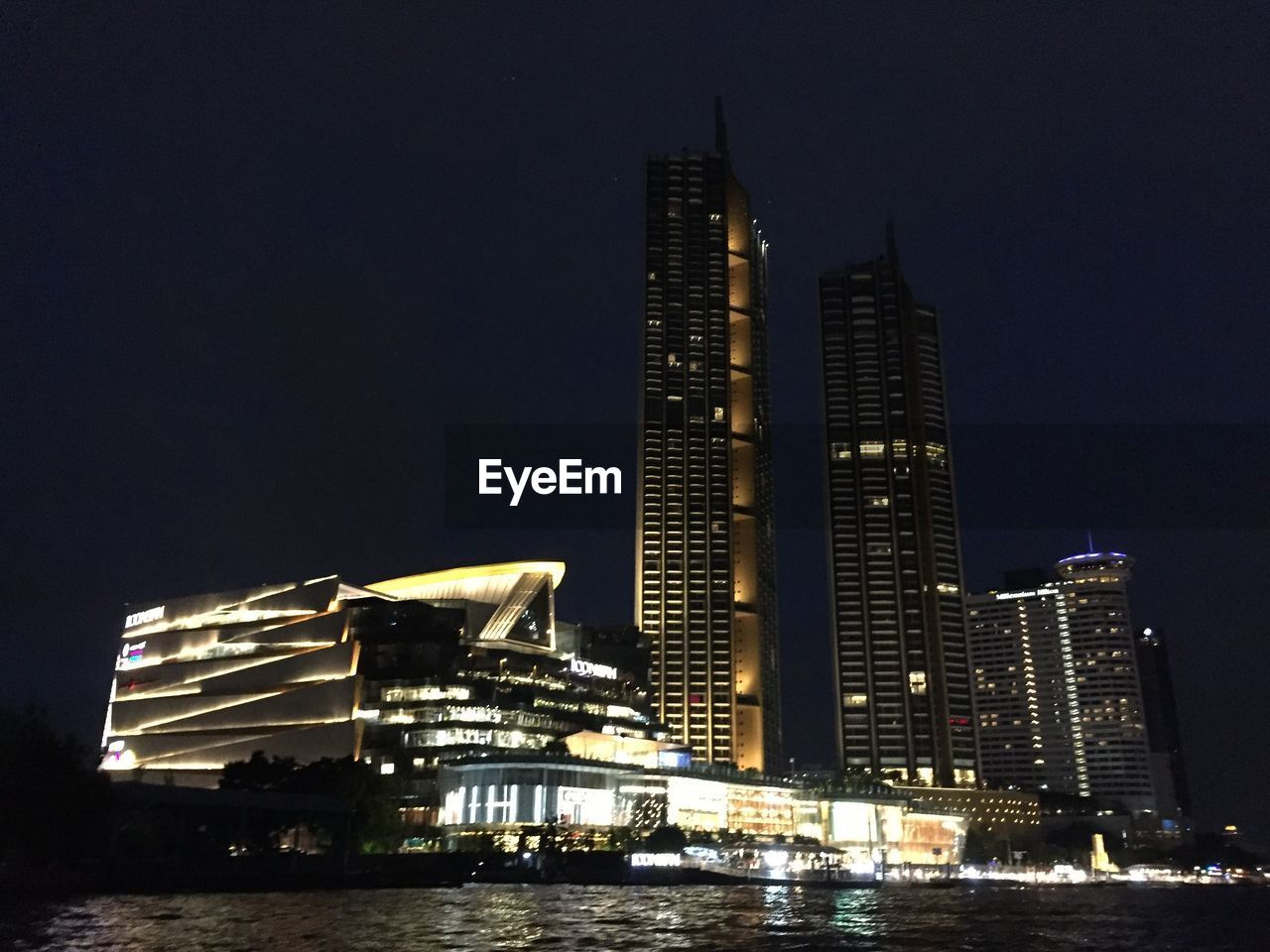 building exterior, built structure, architecture, night, illuminated, city, office building exterior, building, skyscraper, modern, tall - high, sky, water, waterfront, office, no people, nature, tower, travel destinations, cityscape, outdoors, financial district, spire