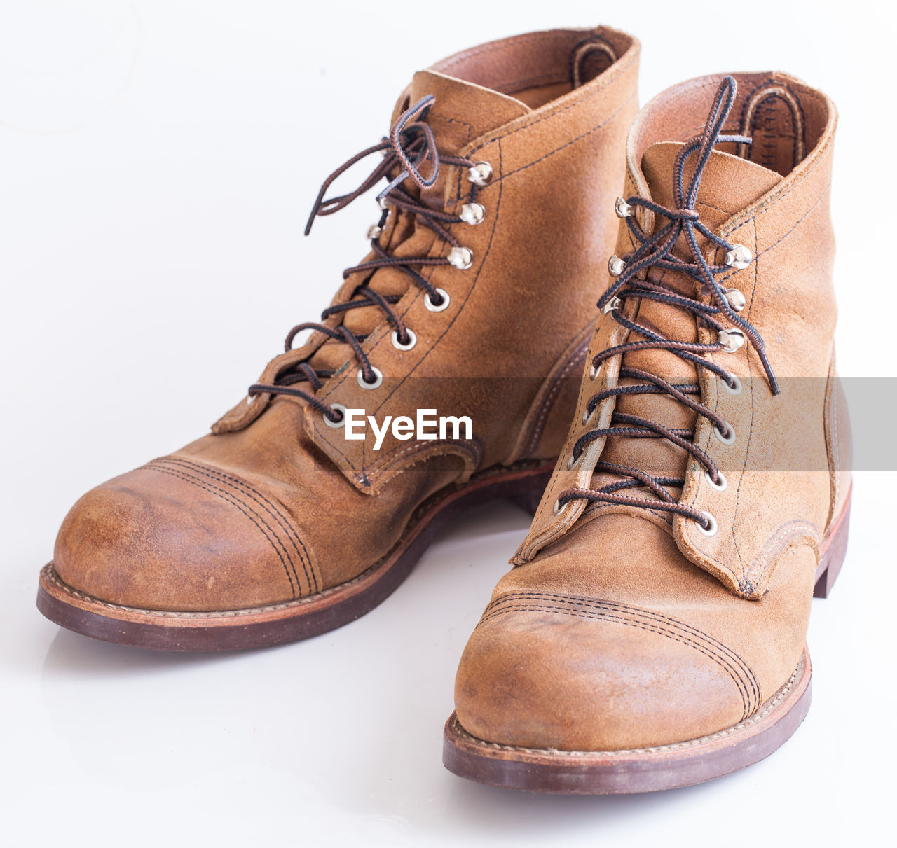 Close-up of boots on white background