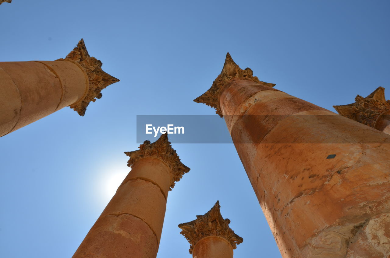 sky, low angle view, the past, architecture, clear sky, no people, history, nature, built structure, travel destinations, representation, tourism, blue, art and craft, day, statue, sculpture, religion, belief, ancient, outdoors, architectural column, ancient civilization, archaeology