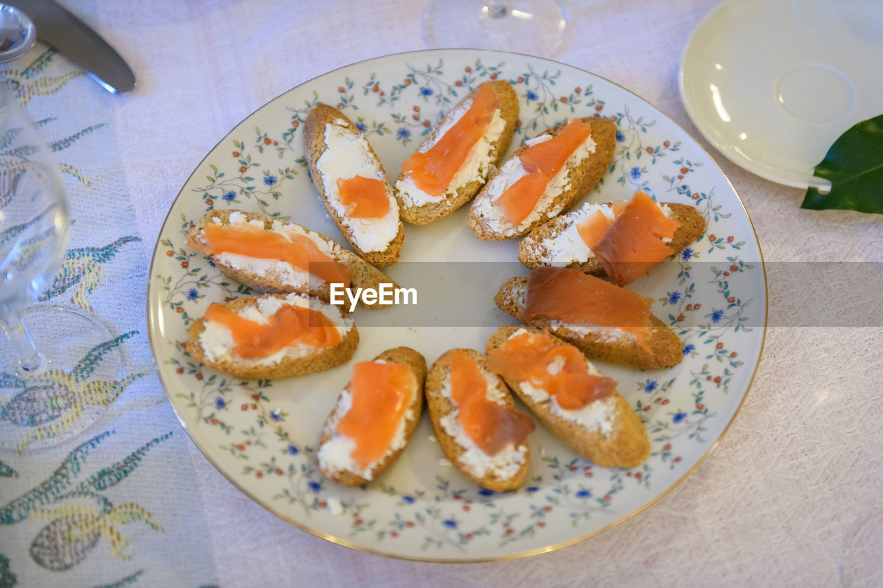 food and drink, food, plate, freshness, ready-to-eat, table, healthy eating, indoors, still life, wellbeing, high angle view, directly above, serving size, no people, close-up, meal, indulgence, bread, orange color, breakfast, snack, temptation, glass