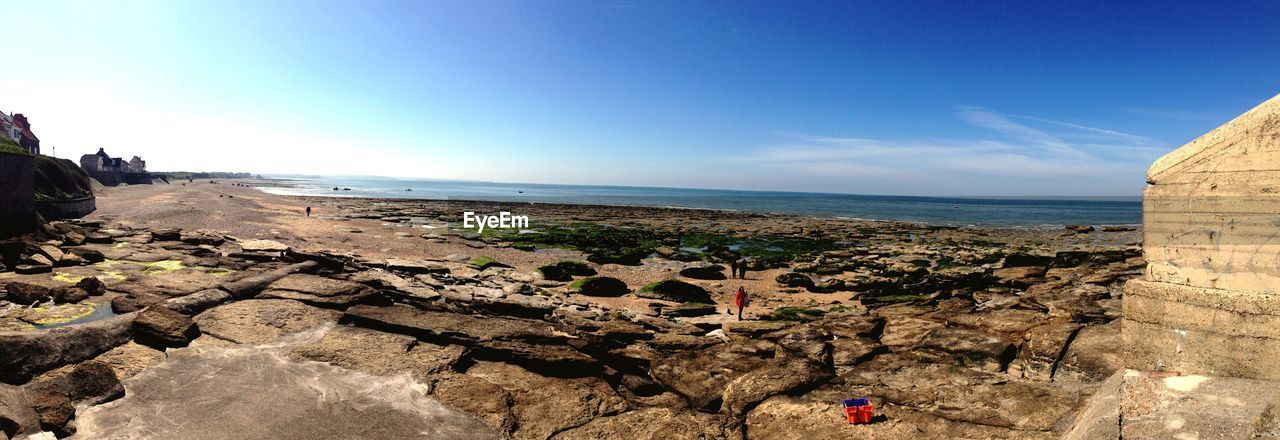 sea, horizon over water, scenics, rock - object, nature, tranquil scene, sky, tranquility, beauty in nature, water, sunlight, outdoors, day, sand, beach, no people, blue, cliff, clear sky
