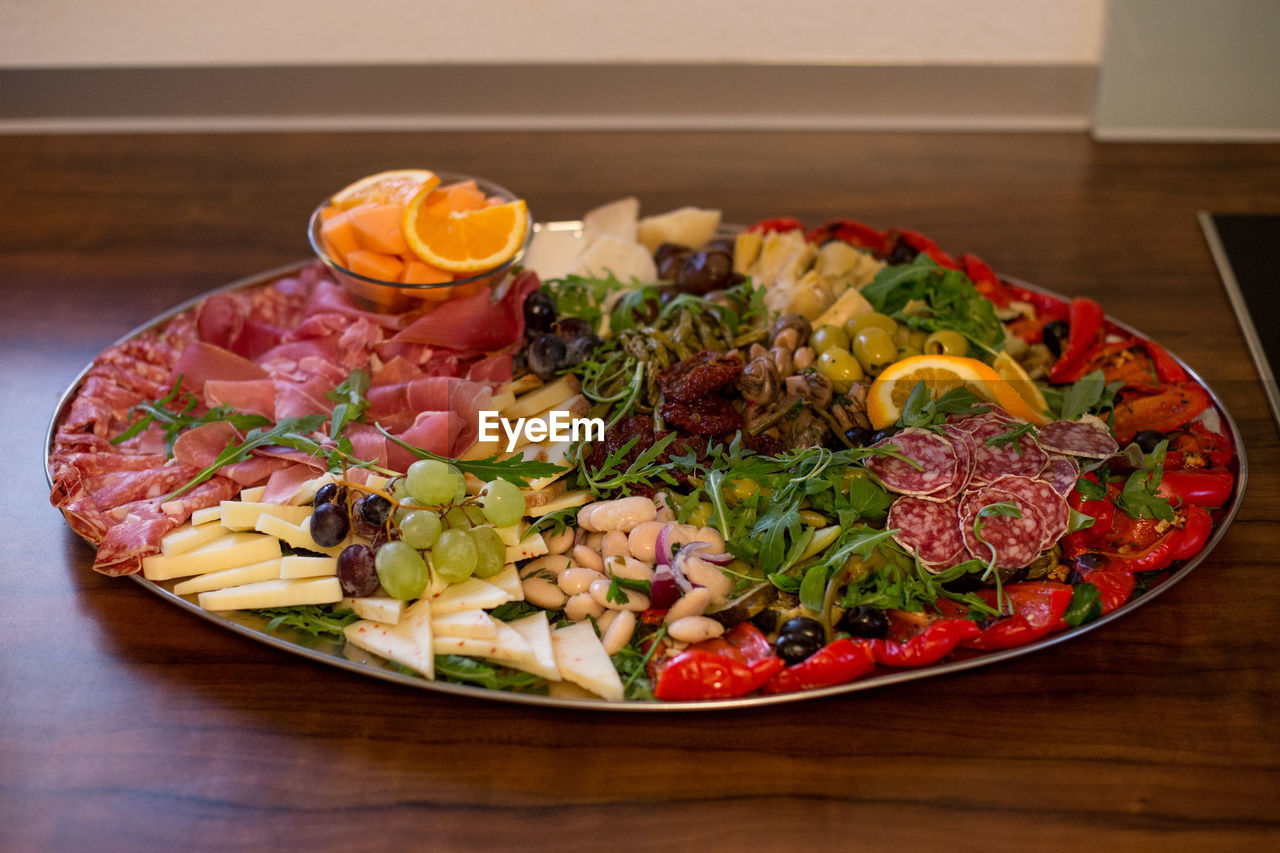 food and drink, food, vegetable, indoors, healthy eating, table, freshness, wellbeing, meat, still life, plate, ready-to-eat, no people, salad, serving size, fruit, meal, close-up, high angle view, wood - material, garnish