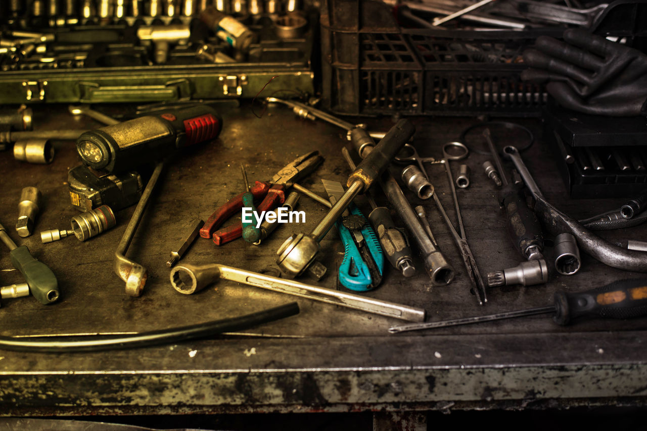 work tool, indoors, still life, metal, hand tool, no people, large group of objects, tool, high angle view, equipment, variation, workshop, choice, close-up, table, screw, abundance, toolbox, focus on foreground, screwdriver, complexity, mechanic, spanner, garage