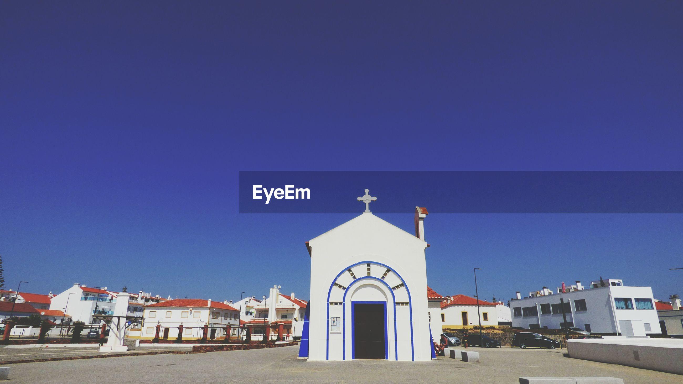 Church against clear blue sky