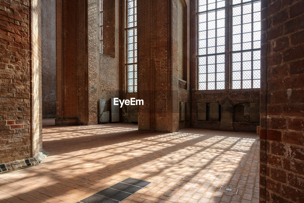 architecture, window, sunlight, built structure, day, building, flooring, shadow, brick, brick wall, no people, wall - building feature, history, architectural column, indoors, wall, the past, nature, old, tiled floor, entrance hall
