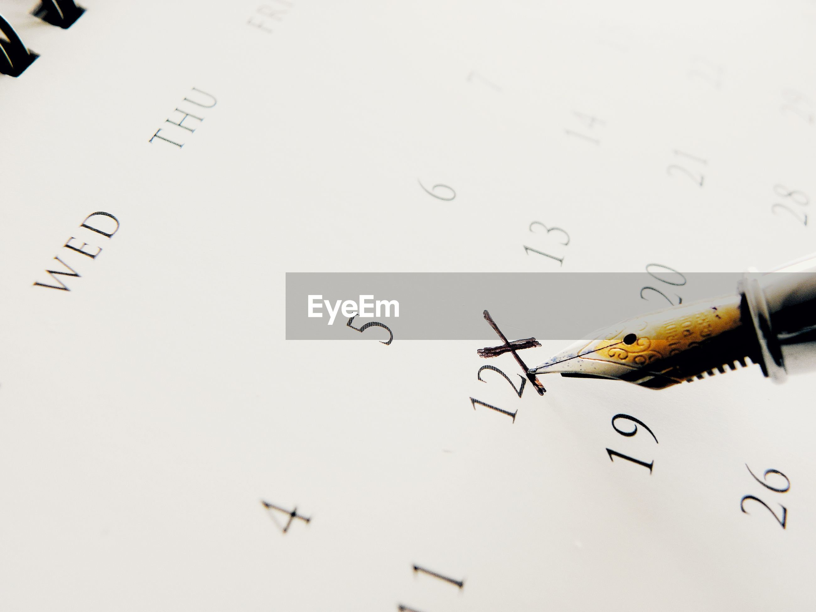 Close-up of text on calendar