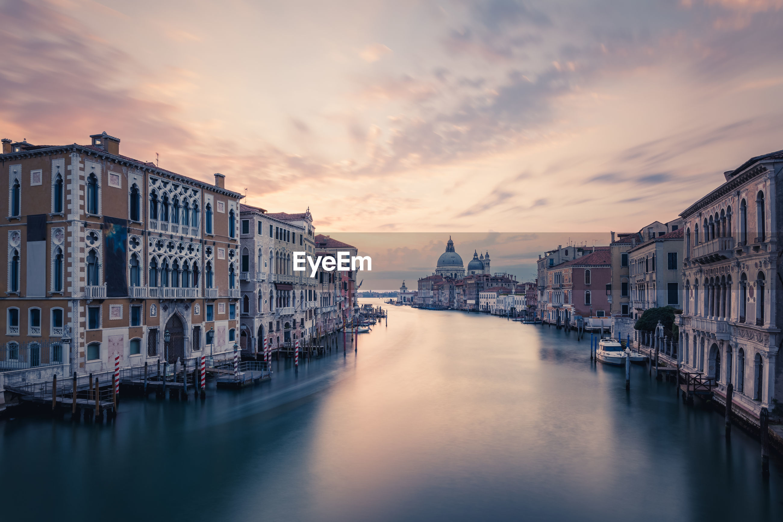 Grand canal against sky during sunset in city