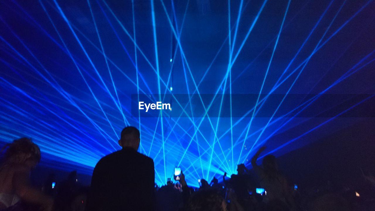 Silhouette People Enjoying Laser Show
