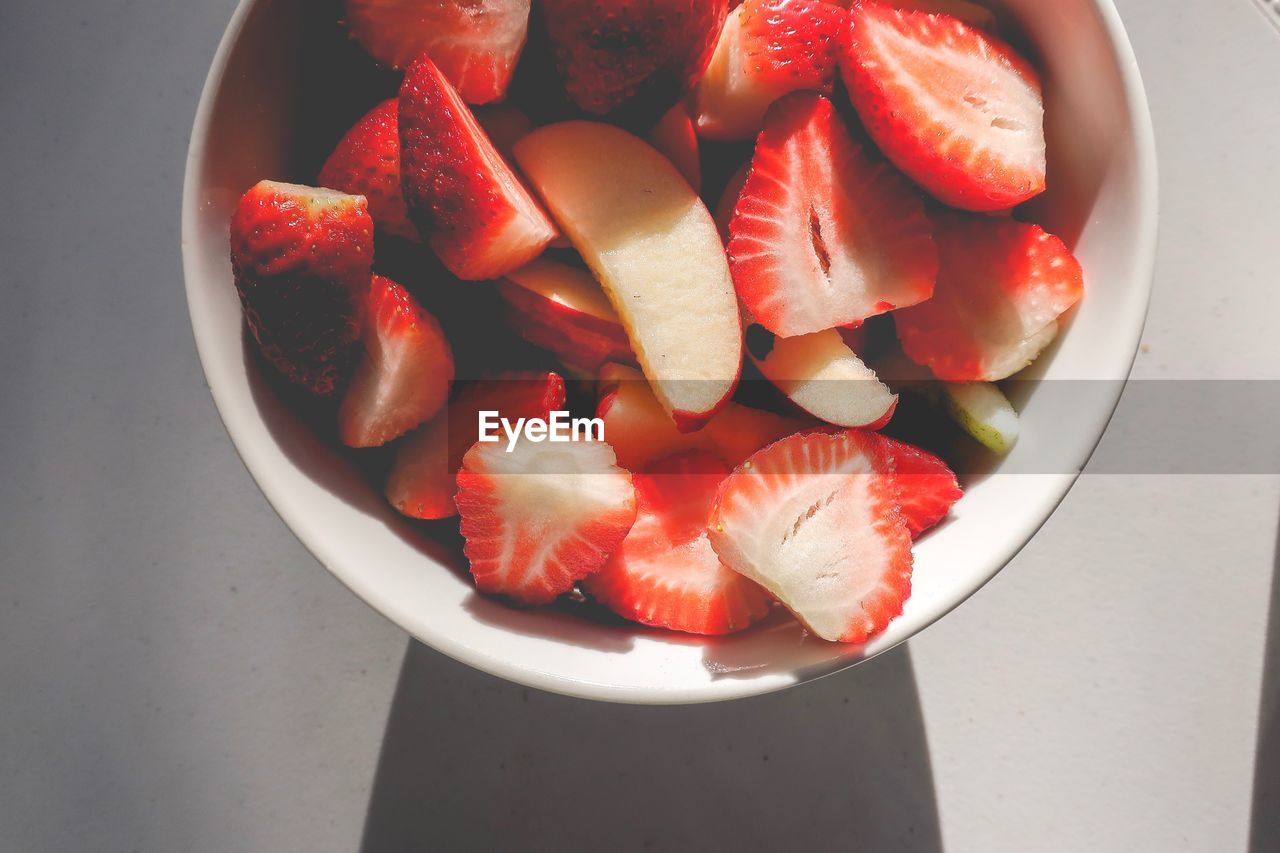 food and drink, food, fruit, healthy eating, wellbeing, red, freshness, strawberry, bowl, still life, berry fruit, indoors, high angle view, vegetable, directly above, slice, chopped, no people, table, close-up, fruit salad