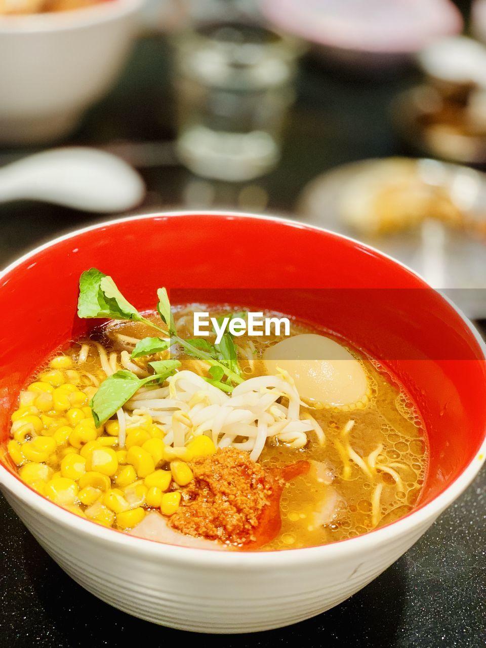 Tonkatsu broth ramen udon with corn ans spicy chilli pastr