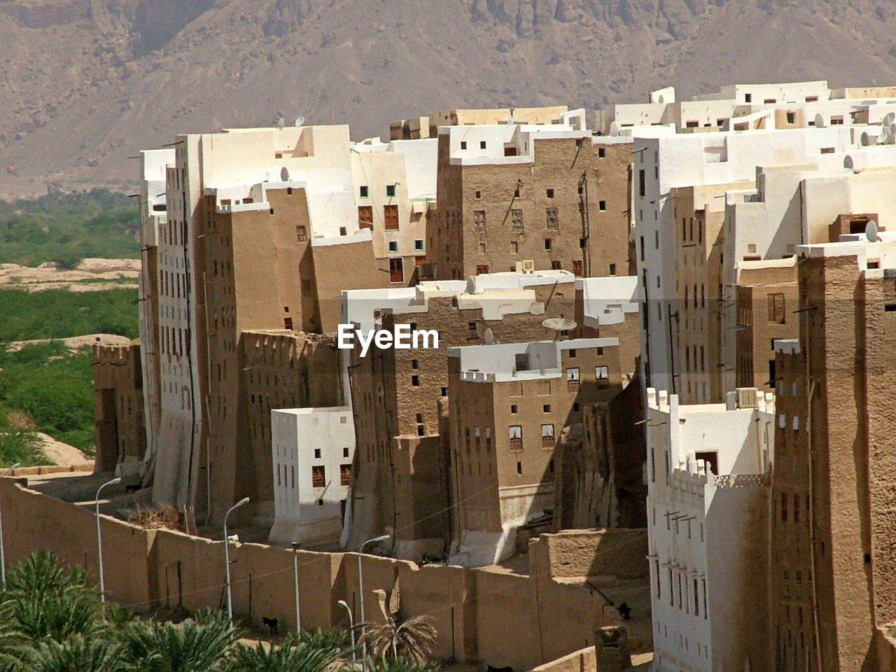 architecture, built structure, building, building exterior, high angle view, city, day, residential district, no people, nature, outdoors, house, travel destinations, travel, sunlight, town, tourism, old, townscape, apartment