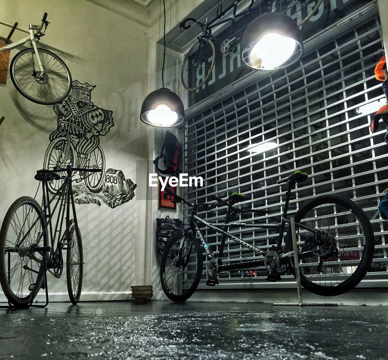 bicycle, illuminated, transportation, indoors, lighting equipment, land vehicle, mode of transport, no people, architecture, stationary, built structure, night