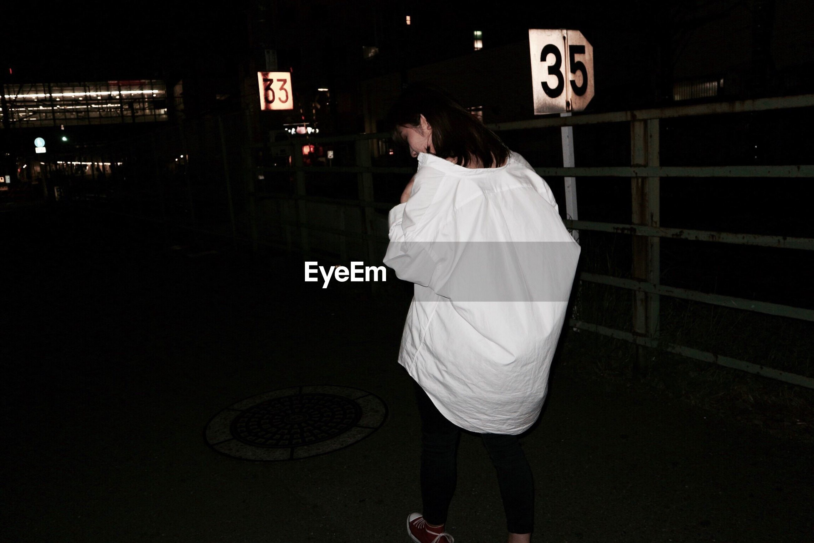 rear view, one person, real people, night, women, outdoors, one woman only, adults only, people, adult