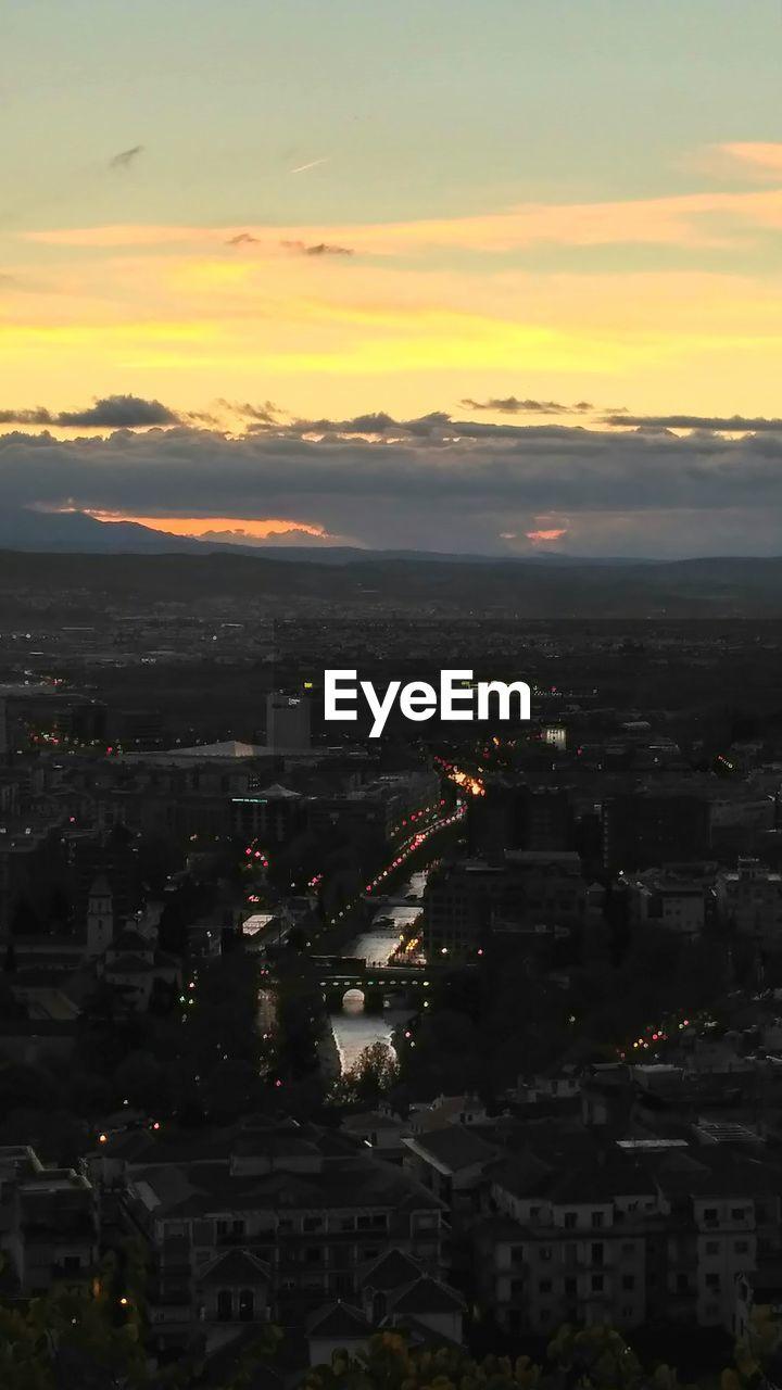 sunset, architecture, sky, orange color, no people, built structure, cityscape, illuminated, building exterior, city, cloud - sky, outdoors, nature