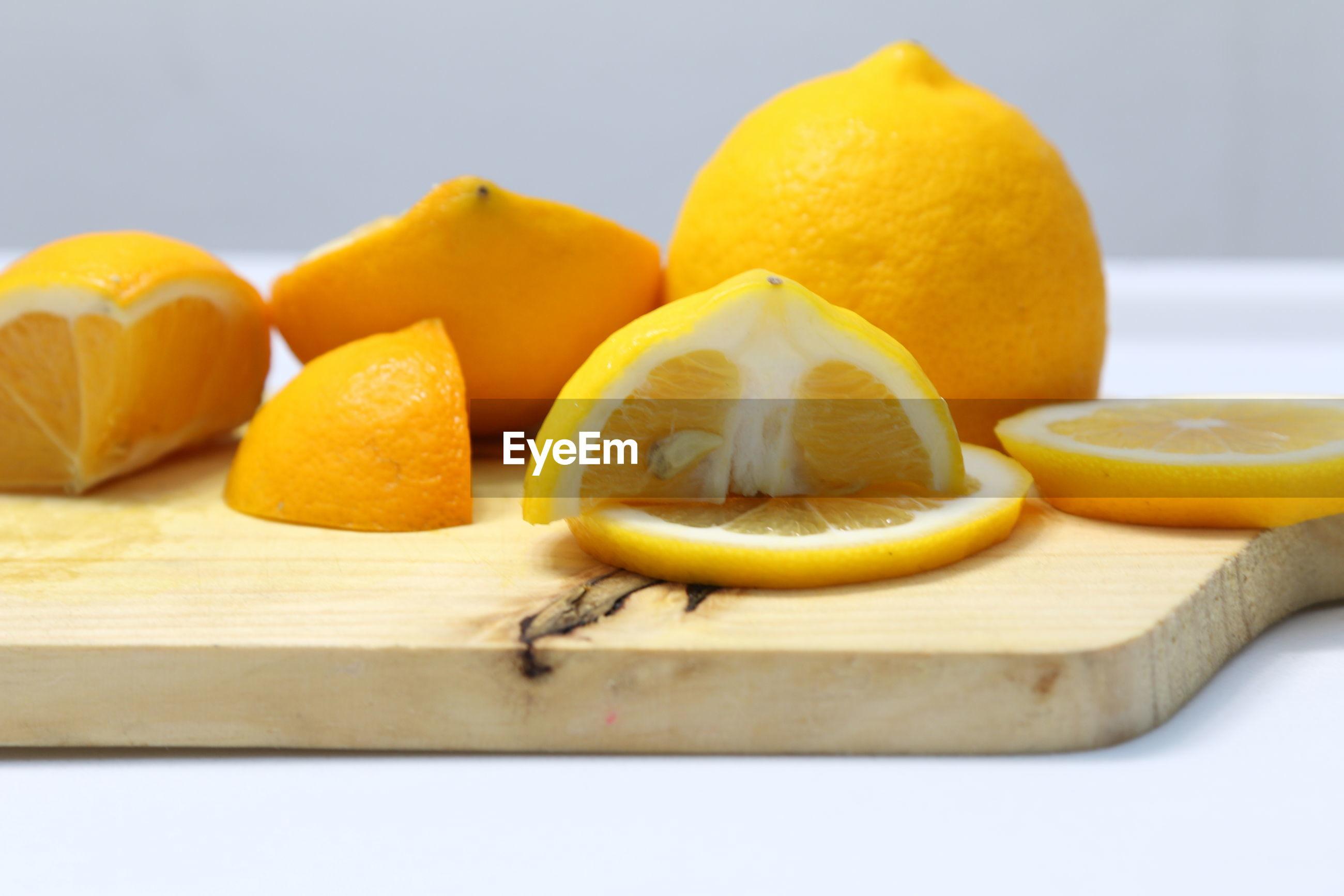 Close-up of lemons on cutting board