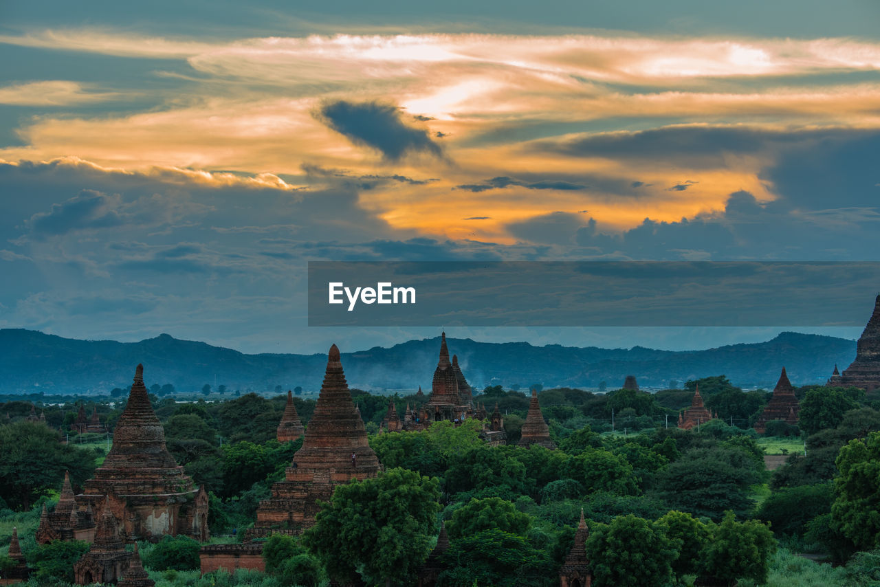 View of temples against cloudy sky