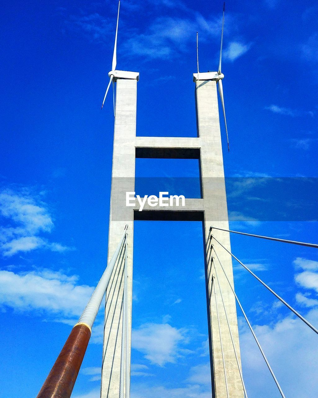Low Angle View Of Bridge Against Blue Sky On Sunny Day
