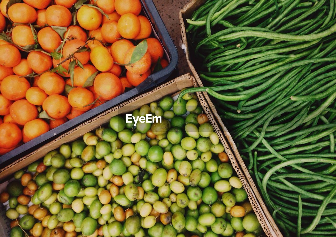 High Angle View Of Vegetables And Fruits In Container
