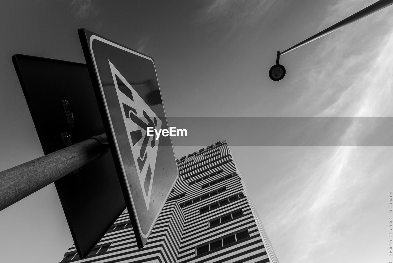 low angle view, communication, architecture, city, built structure, outdoors, skyscraper, modern, day, no people, building exterior, sky