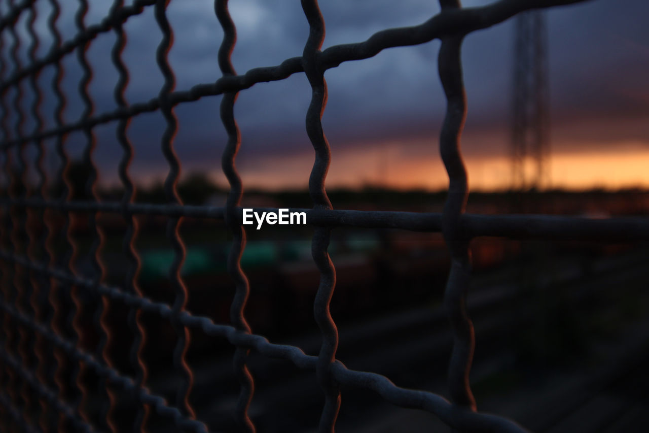 metal, protection, focus on foreground, security, no people, close-up, fence, safety, boundary, nature, water, barrier, sky, selective focus, pattern, sunset, outdoors, full frame, day