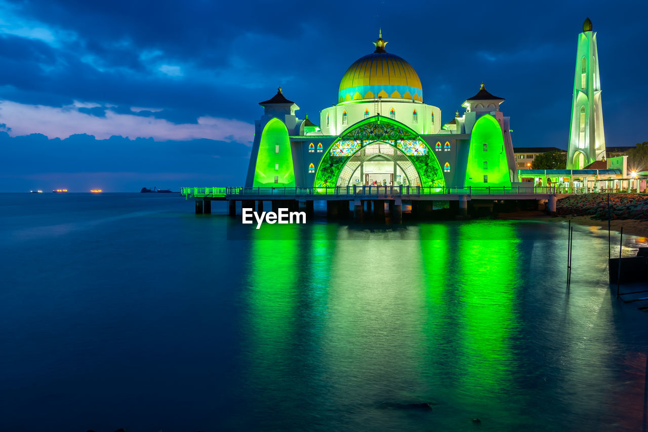 sky, built structure, building exterior, architecture, dome, belief, religion, water, spirituality, place of worship, waterfront, reflection, travel destinations, cloud - sky, nature, no people, illuminated, blue, travel