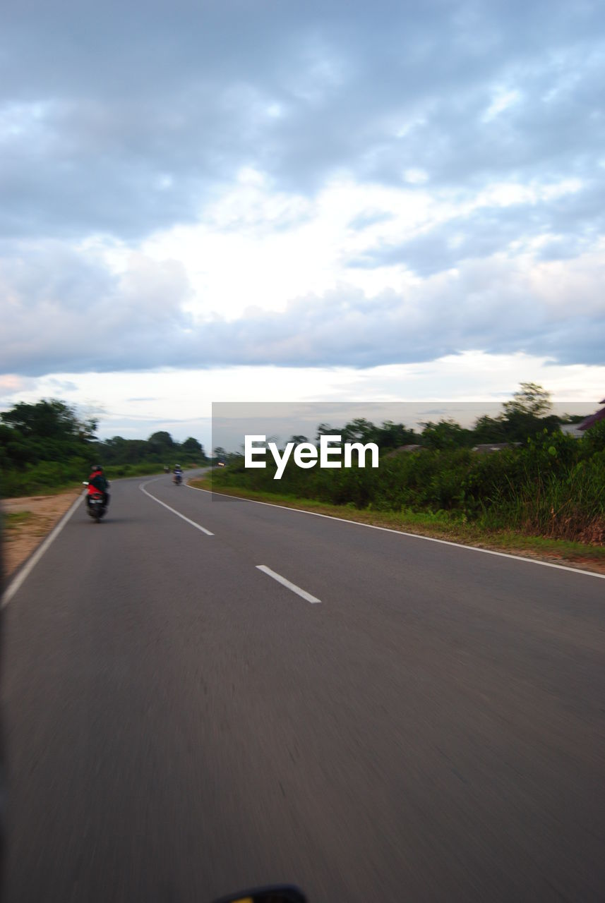 road, transportation, cloud - sky, the way forward, sky, highway, land vehicle, mode of transport, speed, car, nature, day, landscape, outdoors, tree, motion, scenics, road trip, one person, people