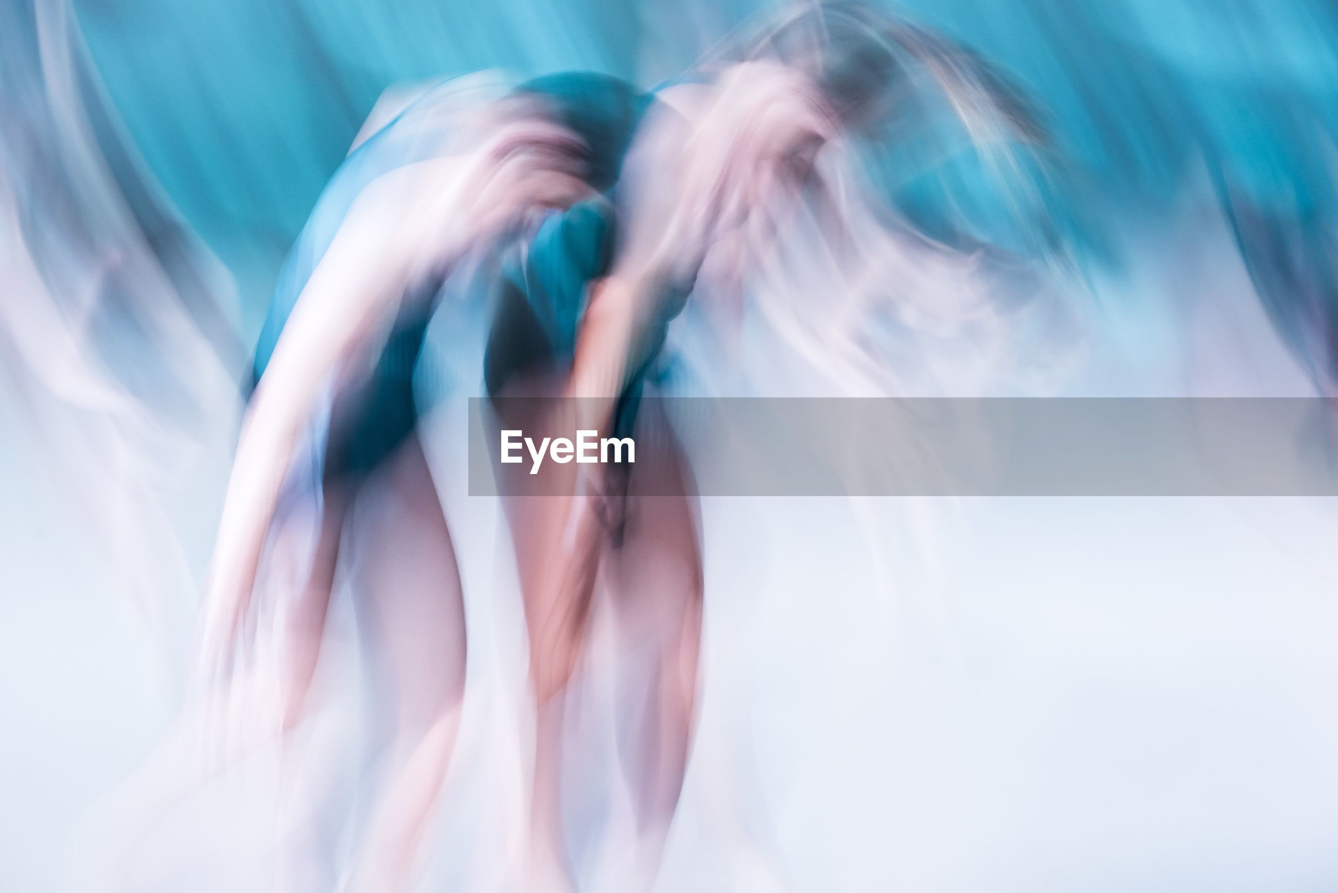 Blurred motion of ballerinas during dance performance