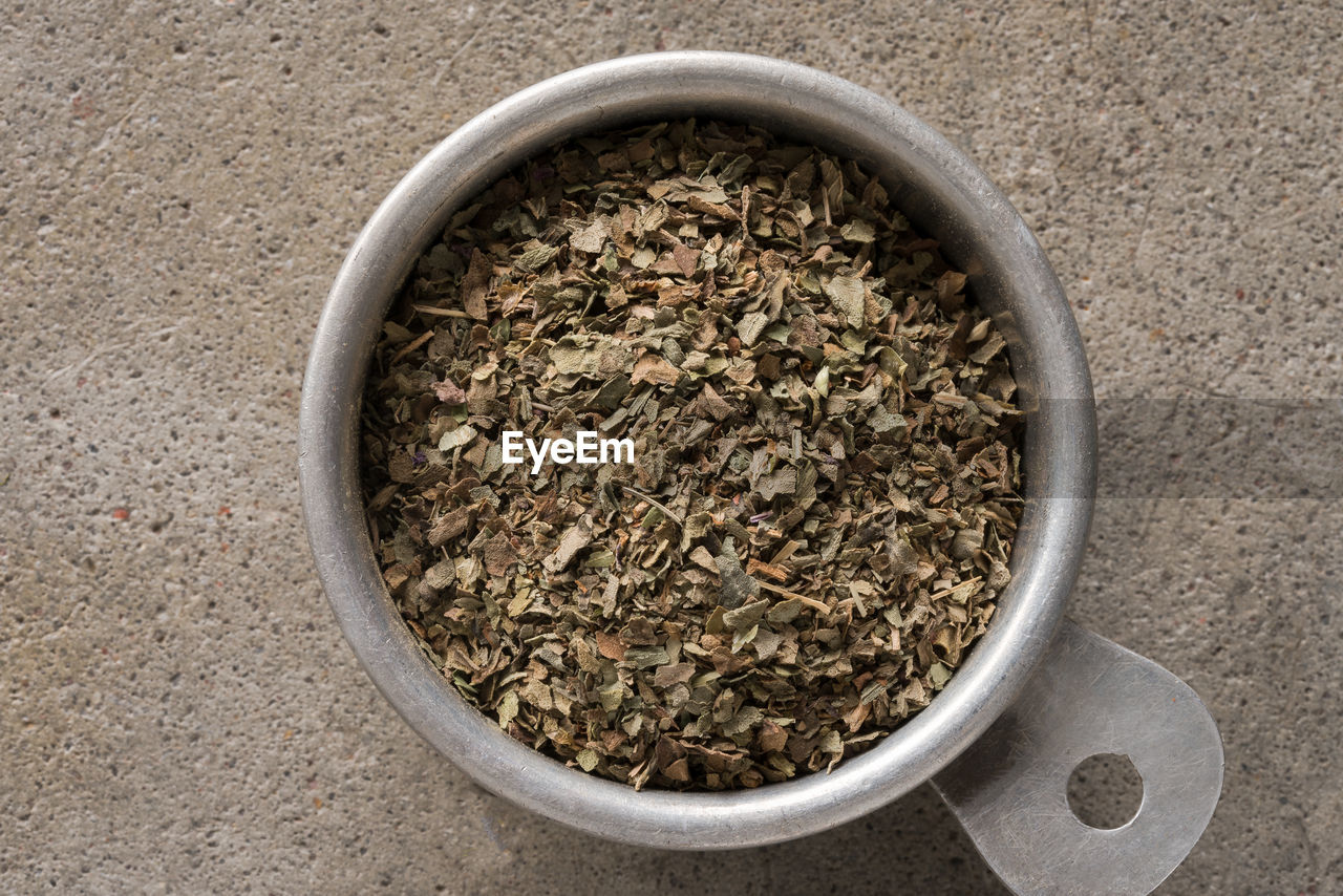 High angle view of dried herbs in bowl