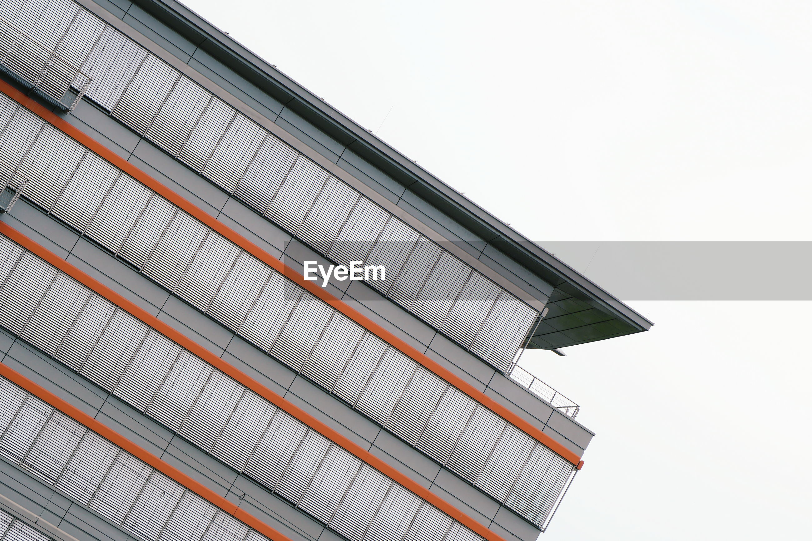 architecture, roof, built structure, facade, building exterior, low angle view, no people, building, sky, line, business, city, clear sky, outdoors, copy space, day, nature, industry