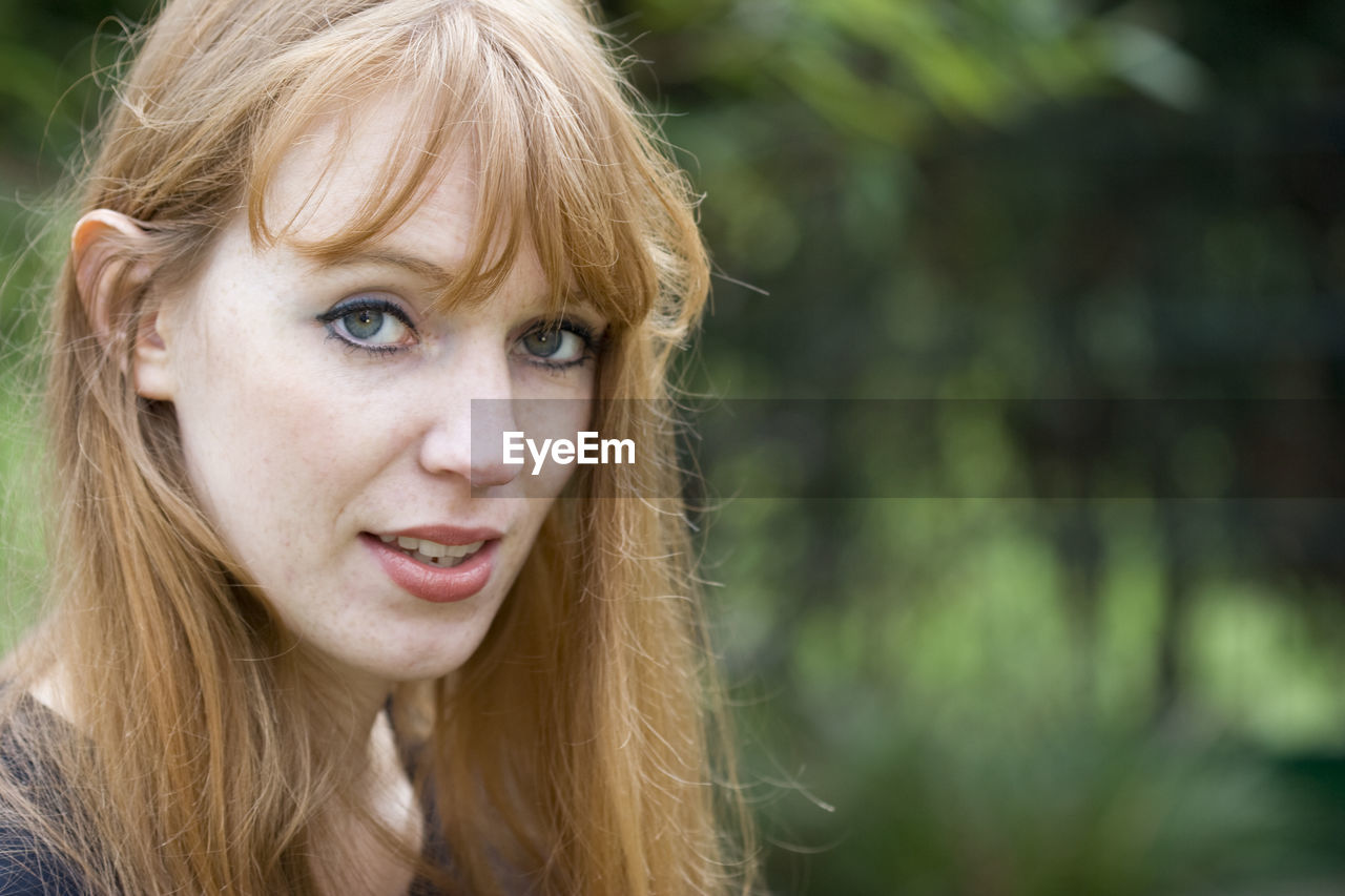 Close-Up Portrait Of Beautiful Woman With Redhead