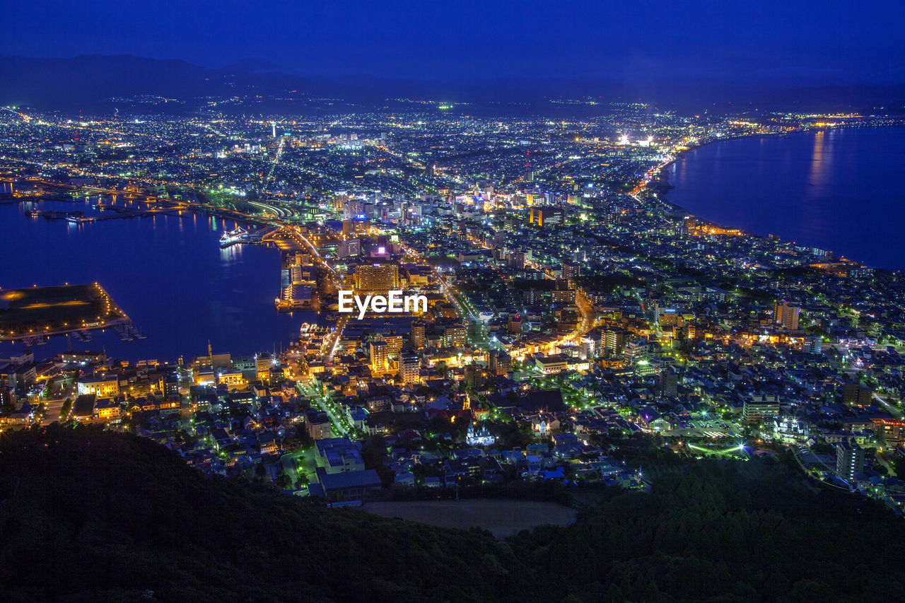 building exterior, city, architecture, built structure, cityscape, illuminated, water, night, building, nature, no people, high angle view, sea, aerial view, residential district, sky, outdoors, office building exterior, modern, bay, skyscraper