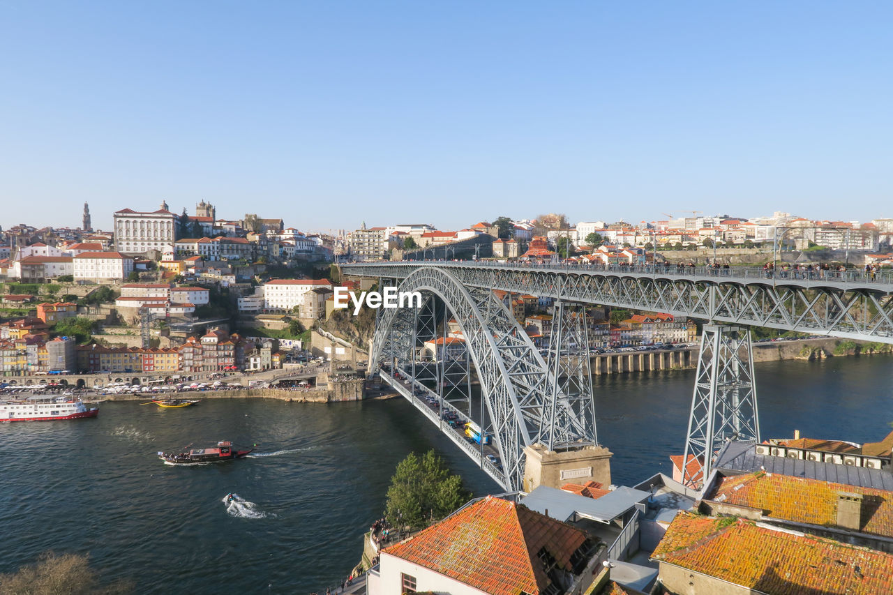 architecture, built structure, building exterior, water, sky, bridge, connection, city, transportation, bridge - man made structure, river, nature, clear sky, day, cityscape, copy space, building, no people, residential district, arch, arch bridge, outdoors