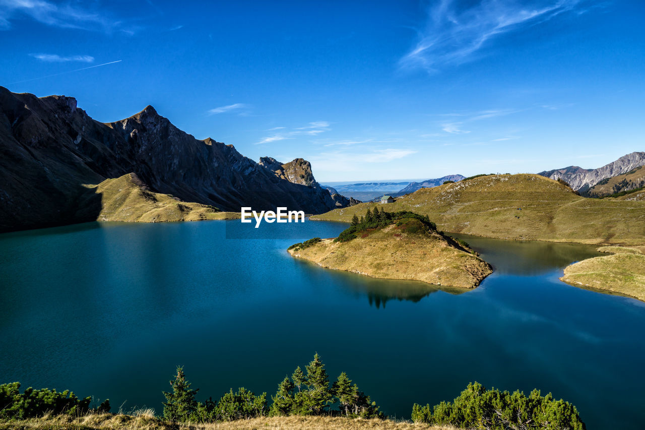 water, scenics - nature, beauty in nature, tranquil scene, mountain, sky, tranquility, lake, idyllic, nature, non-urban scene, blue, mountain range, rock, no people, environment, cloud - sky, day, reflection, outdoors, formation, turquoise colored