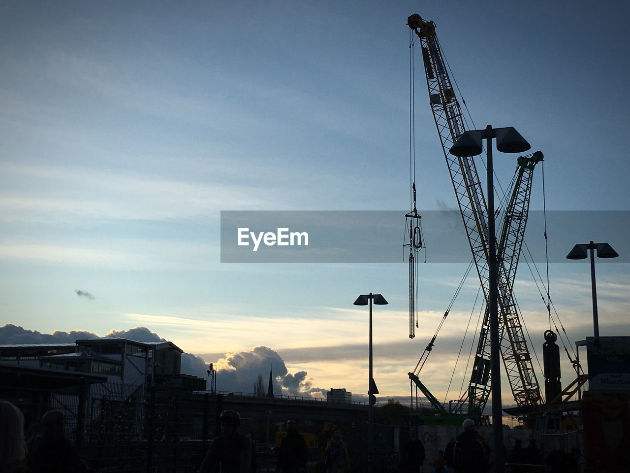 sky, crane - construction machinery, machinery, architecture, construction industry, silhouette, industry, cloud - sky, built structure, nature, sunset, construction site, no people, outdoors, development, building exterior, crane, dusk, construction equipment, construction machinery