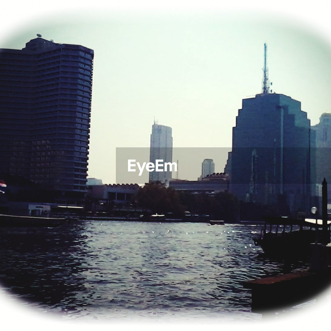 architecture, city, building exterior, skyscraper, built structure, modern, tower, river, cityscape, water, skyline, development, waterfront, city life, no people, travel destinations, downtown district, outdoors, urban skyline, tall, sky, day, high