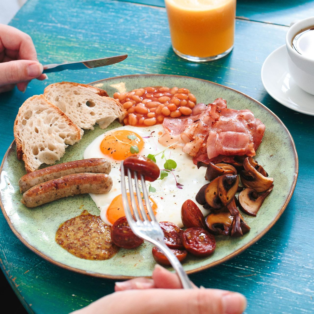 High Angle View Of Person Having English Breakfast At Table