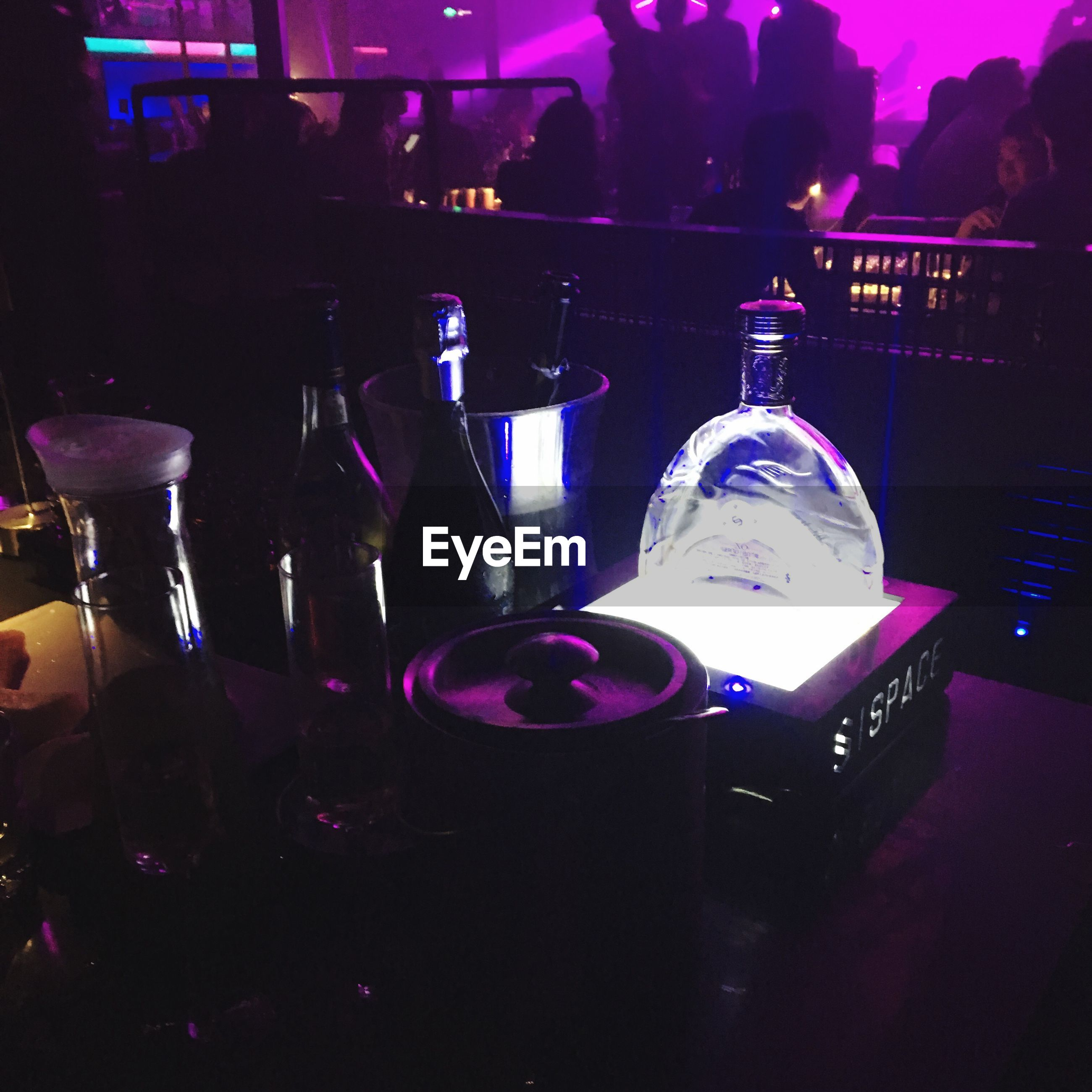 drink, absence, table, food and drink, group of objects, dark, wine glass, nightlife, bar counter, arrangement, blue, no people, large group of objects