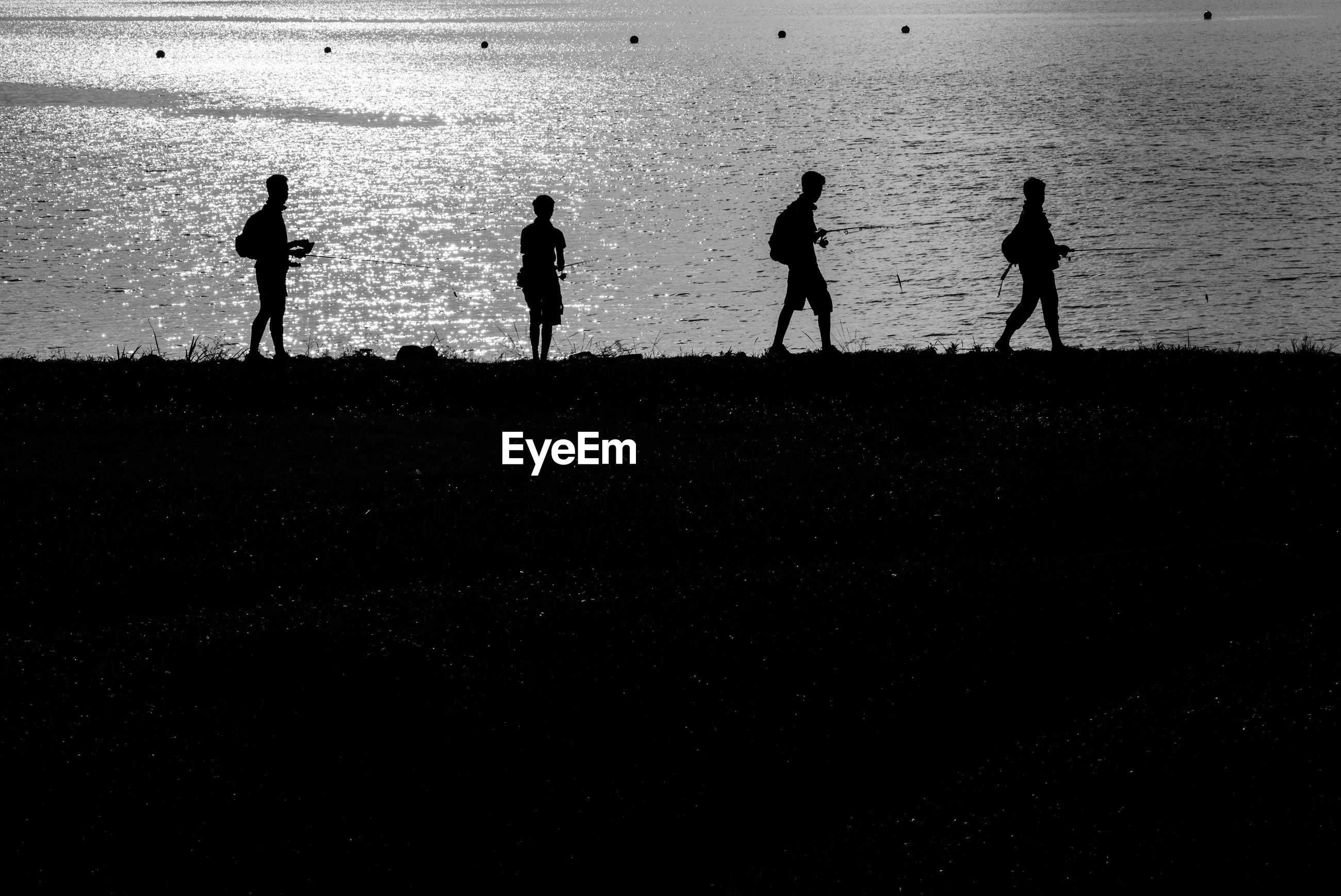 silhouette, men, togetherness, lifestyles, leisure activity, walking, person, large group of people, medium group of people, bonding, standing, friendship, water, outline, outdoors, shadow