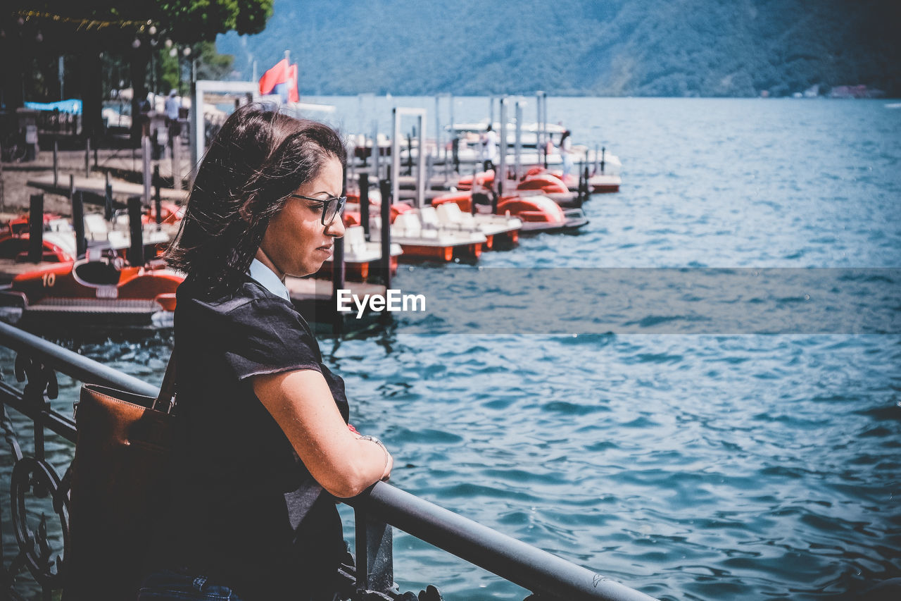 Side View Of Woman Looking At Boat In Sea